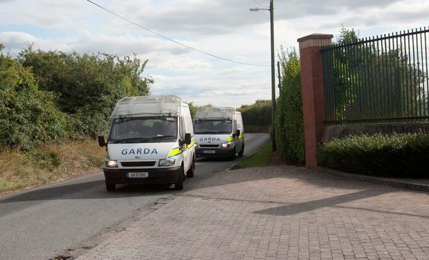 Two garda vans arrive after the incident at Oberstown began yesterday afternoon. Photo: Gareth Chaney Collins