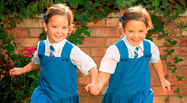 Twins Rosie (left) and Ruby Formosa who were born joined at the abdomen and shared part of the intestine, are due to start school in September: Dominic Lipinski/PA Wire