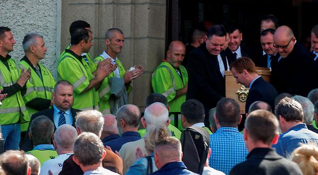 The remains of Trevor O'Neill are taken from St. Bernadette's on Clogher Rd. in Crumlin.