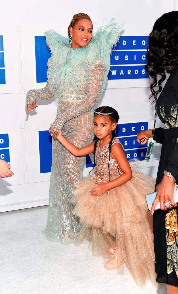 Beyonce, left, and her daughter Blue Ivy arrive at the MTV Video Music Awards at Madison Square Garden on Sunday, Aug. 28, 2016, in New York. (Photo by Evan Agostini/Invision/AP)