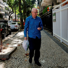 Pat Hickey arrives at a residential building in Rio yesterday. Photo: Reuters