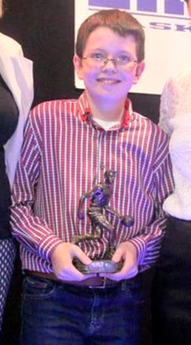 Niall Hawe receives the 'most improved player' award at a recent ceremony for the the East Cavan Eagles Basketball Club