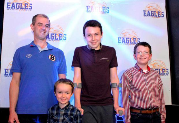 Alan Hawe with his sons, left to right, Ryan (6), Liam (13) and Niall (11)