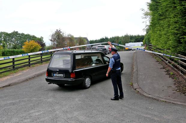 Hearses arrive at The scene at Oakdene Barcroney Ballyjamesduff, Co. Cavan where the bodies of a family of five were found. Photo: Colin Keegan, Collins Dublin.