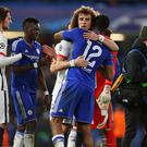 LONDON, ENGLAND - MARCH 09: David Luiz of Paris Saint Germain hugs Mikel John Obi of Chelsea at the end of the UEFA Champions League match between Chelsea and Paris Saint-Germain at Stamford Bridge on March 9, 2016 in London, United Kingdom. (Photo by Catherine Ivill - AMA/Getty Images)