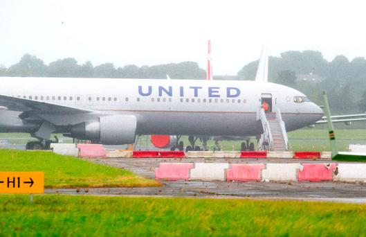 Engineers inspecting the United Airlines Boeing 767-300 that made an emergency landing at Shannon Airport yesterday. Photo: Brian Gavin