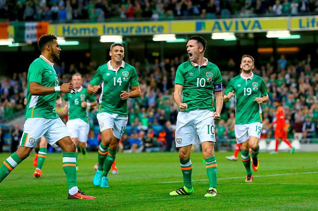 Robbie Keane celebrates scoring his sides second goal of the match. Photo: Brian Lawless/PA Wire.
