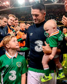 Robbie Keane with sons Robert and Hudson after bowing out of his international career with a 68th goal for Ireland last night. Photo by David Maher/Sportsfile