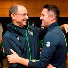 Republic of Ireland manager Martin O'Neill, left, congratulates Robbie Keane in the dressing room following the Three International Friendly game between the Republic of Ireland and Oman at the Aviva Stadium in Lansdowne Road, Dublin. Photo by David Maher/Sportsfile