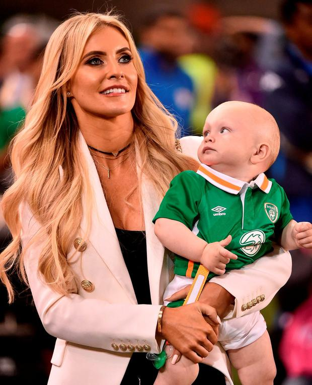 Claudine Keane, wife of Robbie, and their son Hudson watch on during Robbie's final game for Ireland against Oman at the Aviva Stadium last night. Photo by David Maher/Sportsfile