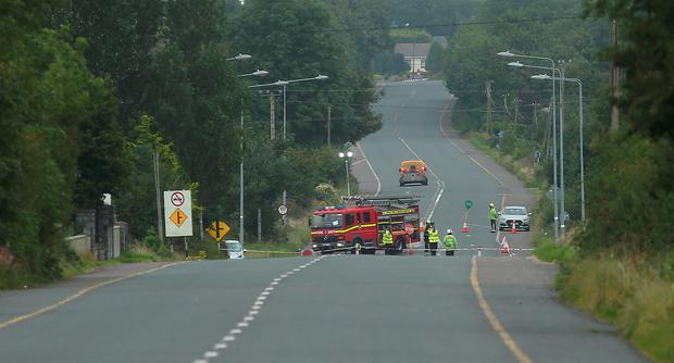 Gardai at the R446 Moate to Horseleap road where an 11 year old boy lost his life this morning. Picture credit; Damien Eagers