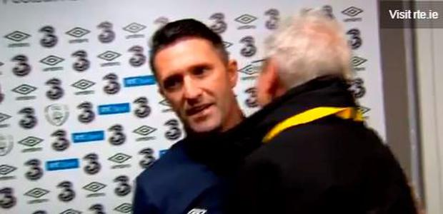 Robbie Keane and Tony O'Donoghue embrace after the Oman game - Keane's last in a green shirt