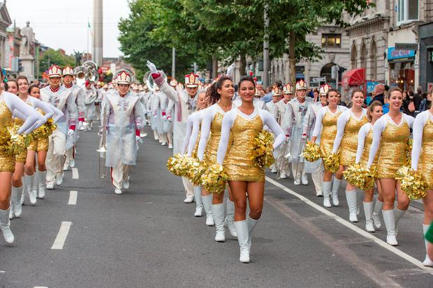 American Football Showcase High School Teams parade down O'Connell street to a pep rally in Trinity College, Dublin. Picture: Arthur Carron