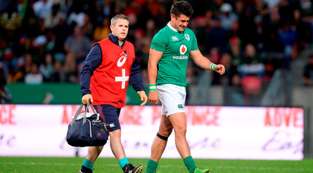 Tiernan O'Halloran, being led off the field against the Boks, has had to stagger his return to training after the South African tour. Photo by Brendan Moran/Sportsfile