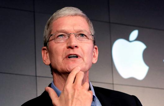 Apple CEO Tim Cook Photo: AP Photo/Richard Drew
