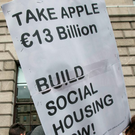 People sign a petition outside the GPO over the €13bn in taxes that Apple now owes Photo: Mark Condren