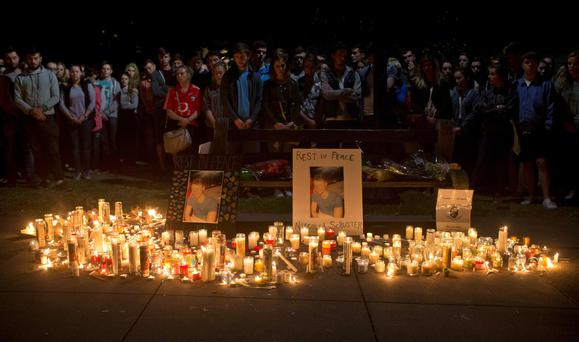 Mourners attend a candlelight vigil for the six Irish students who died in Berkeley Photo: AP Photo/Beck Diefenbach