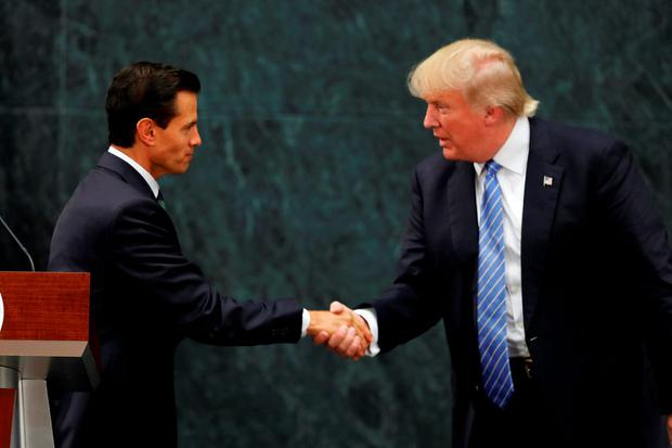 Mexico President Enrique Pena Nieto and Republican presidential nominee Donald Trump shake hands after a joint statement at Los Pinos, the presidential official residence, in Mexico City. Photo: AP