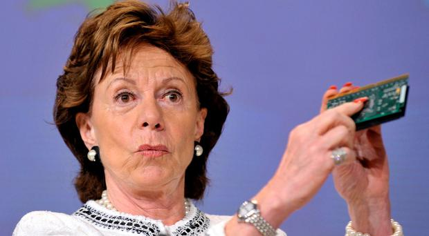 Neelie Kroes, former EU competition commissioner, famously tackled the multinational mobile phone companies over outrageous roaming charges Photo: Jock Fistick/Bloomberg News