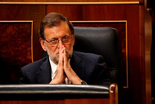 Spain's acting Prime Minister and People's Party leader Mariano Rajoy