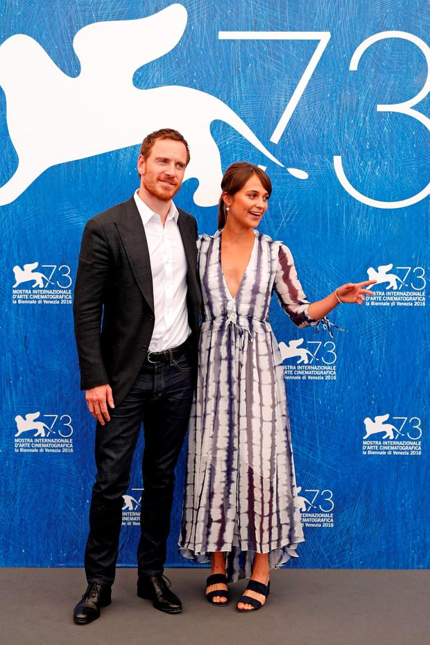 Actors Alicia Vikander and Michael Fassbender attend a photocall for 'The Light Between Oceans' during the 73rd Venice Film Festival