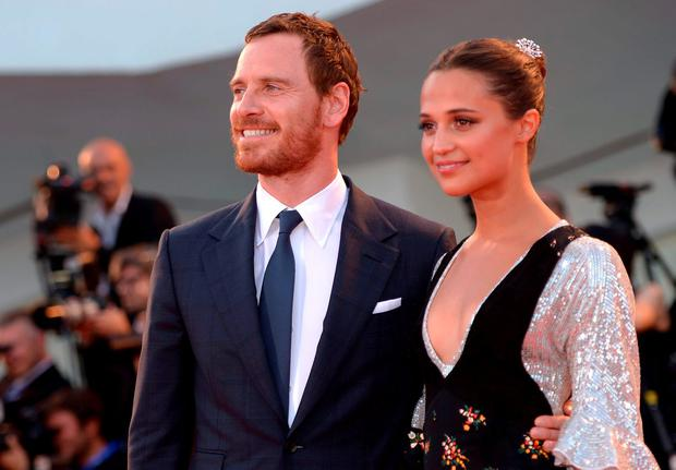 Swedish actress Alicia Vikander and Michael Fassbender pose on the red carpet before the premiere of the movie