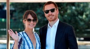 Michael Fassbender (R) and actress Alicia Vikander pose as they arrive at the Excelsior Hotel to promote the movie