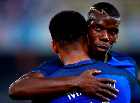 France's forward Anthony Martial (L) is congratulated by France's midfielder Paul Pogba