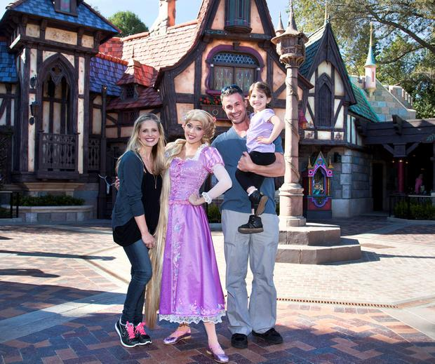 Sarah Michelle Gellar, Freddie Prinze Jr. and their daughter Charlotte meet Rapunzel at the all-new