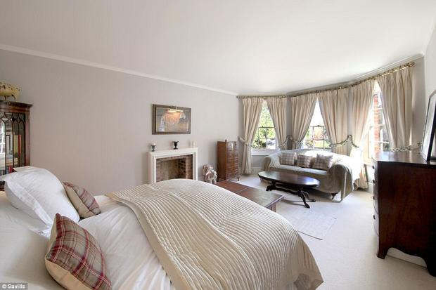 he master bedroom is a fine room with deep bay sash windows and a working fireplace.