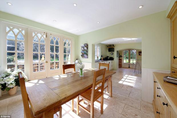 At 27' long, the impressive formal dining room is perfect for family gatherings or large-scale entertaining