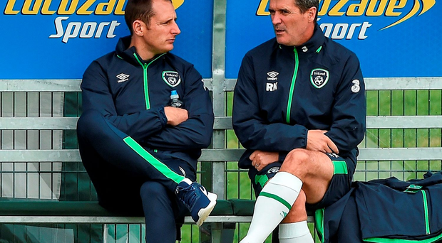 Ireland assistant manager Roy Keane chats with goalkeeper Gary Rogers