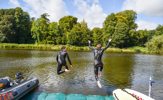 The first swimmers have jumped into Stradbally Hall estate's lake. Photo: Electric Picnic