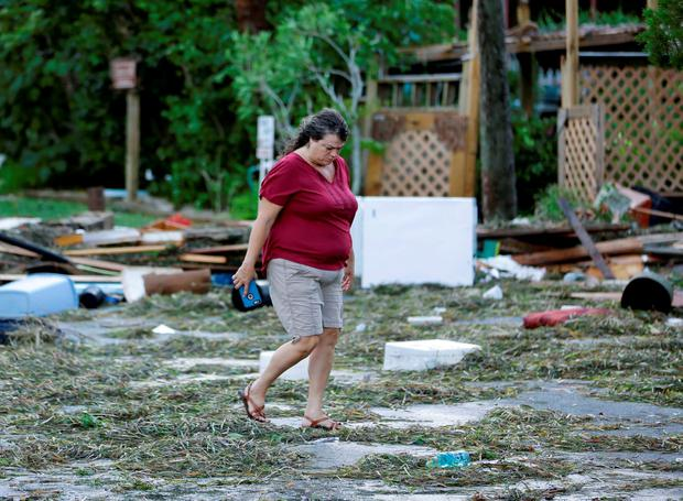 A resident checks on damage from Hurricane Hermine Friday, Sept. 2, 2016, in Cedar Key, Fla. Hermine was downgraded to a tropical storm after it made landfall