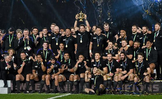 31 October 2015; New Zealand captain Richie McCaw lifts the Webb Ellis Cup surrounded by team-mates. 2015 Rugby World Cup Final, New Zealand v Australia. Twickenham Stadium, Twickenham, London, England. Picture credit: Stephen McCarthy / SPORTSFILE (Photo by Sportsfile/Corbis via Getty Images)