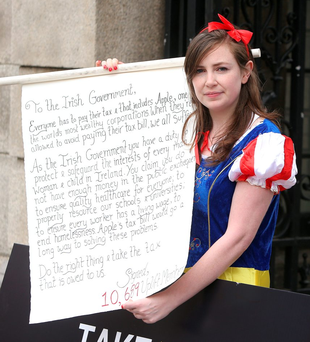 Emily Duffy, of Uplift, dressed as Snow White, holds an open letter to the Government outside Leinster House yesterday Photo: Damien Eagers