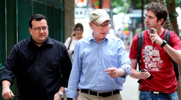 Journalist Cathal McMahon (right) speaks to Pat Hickey (centre) in Rio de Janeiro Photo: Steve Humphreys