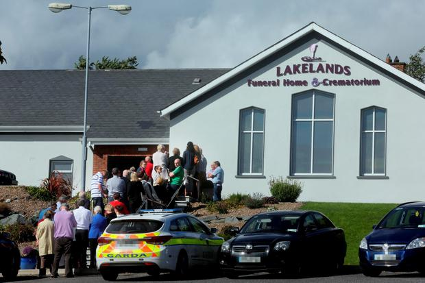 Mourners console each other at the Lakelands funeral home in Cavan Photo: Tony Gavin