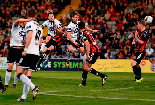 Brian Gartland, left, of Dundalk shoots to score his side's first goal. Photo: Sportsfile
