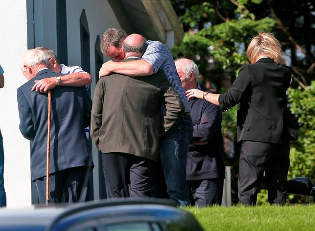 Mourners at the Lakelands Funeral Home in Cavan Town