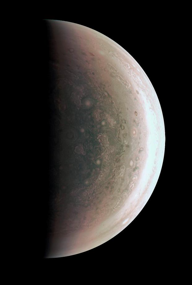 The JunoCam instrument acquired the view on August 27, 2016, when the spacecraft was about 58,700 miles (94,500 kilometers) above the polar region. At this point, the spacecraft was about an hour past its closest approach, and fine detail in the south polar region is clearly resolved