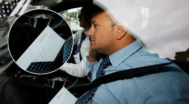 Social Protection Minister Leo Varadkar arriving at Government Buildings with the All-Ireland hurling final tickets on his lap marked for two Fine Gael politicians