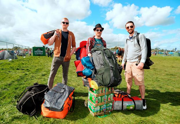 Barry Ryan, 30, from Naas, Craig Berkeley, 31, from Dublin 8, and Eoin Ryan, 31, from Naas, making their way to the campsite. Electric Picnic Festival - Friday. Stradbally, Co. Laois. Picture: Caroline Quinn