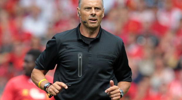 Referee Mark Halsey seen during the pre-season friendly football match between Liverpool and Olympiakos at Anfield Stadium in Liverpool, northwest England on August 3, 2013. The game is a testimonial match for Liverpool captain Steven Gerrard who recently signed a new two-year contract extension with Liverpool, the only club he has ever played for. AFP PHOTO/LINDSEY PARNABY (Photo credit should read LINDSEY PARNABY/AFP/Getty Images)