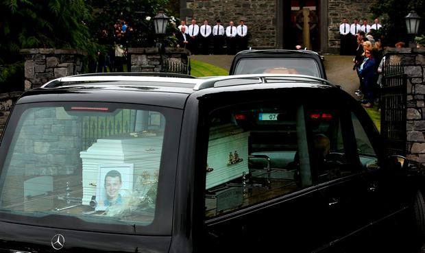 The remains of Liam Hawe follow his mother Clodagh as they arrive at the church for funeral mass in Castlerahan. Photo:Gerry Mooney.