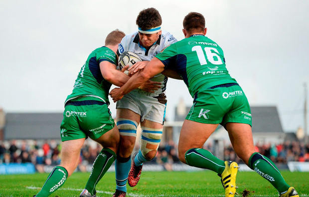 Lewis Wynne of Glasgow Warriors is tackled by Matt Healy, left, and Dave Heffernan of Connacht