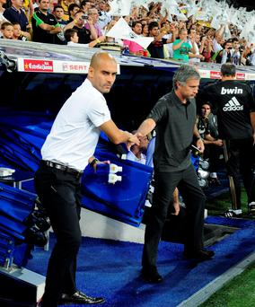 Pep Guardiola and Jose Mourinho — 'Two new managers pretending to be unconcerned about their previous rivalry in Spain'. Photo: Getty Images