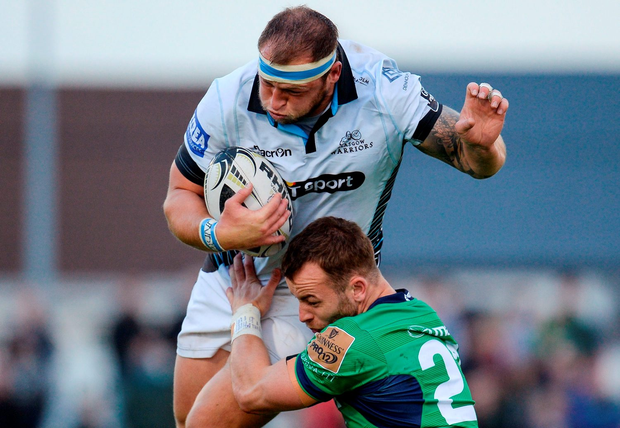 Glasgow Warriors' Ryan Grant is tackled by Connacht's Shane O'Leary. Photo: Seb Daly/Sportsfile