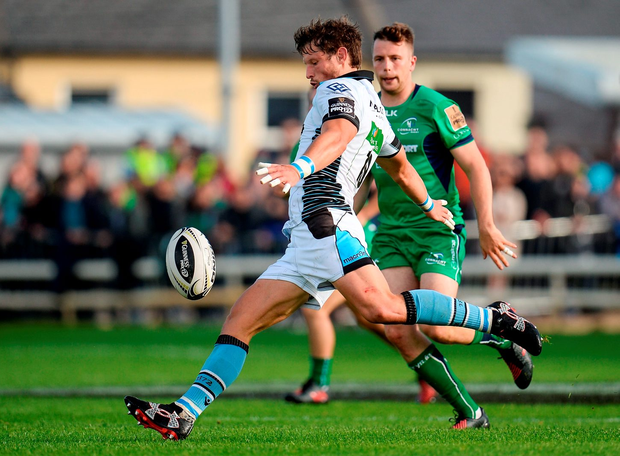 Glasgow Warriors' Peter Horne kicks the ball downfield during the Guinness PRO12 Round 1 match between Connacht and Glasgow Warriors. Photo: Seb Daly/Sportsfile