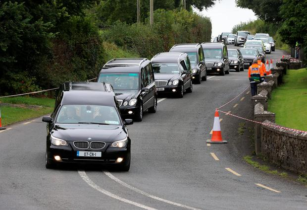 The five hearses carrying the remains of the Hawe Family, Alan and Clodagh and their three children as they made their way to St Mary's Church Castlerahan near Ballyjamesduff Photo: Frank McGrath